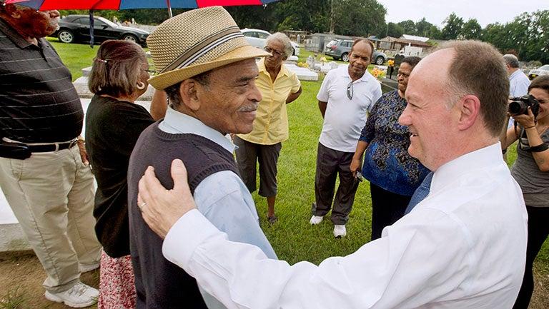 President John J. DeGioia shakes hands with GU 272 descendant Johnny Harris in Louisiana