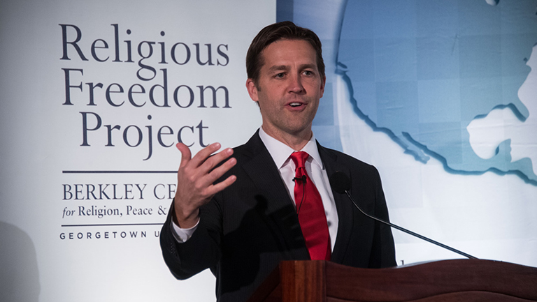 """Ben Sasse speaking at podium in front of a sign reading """"Religious Freedom Project"""""""