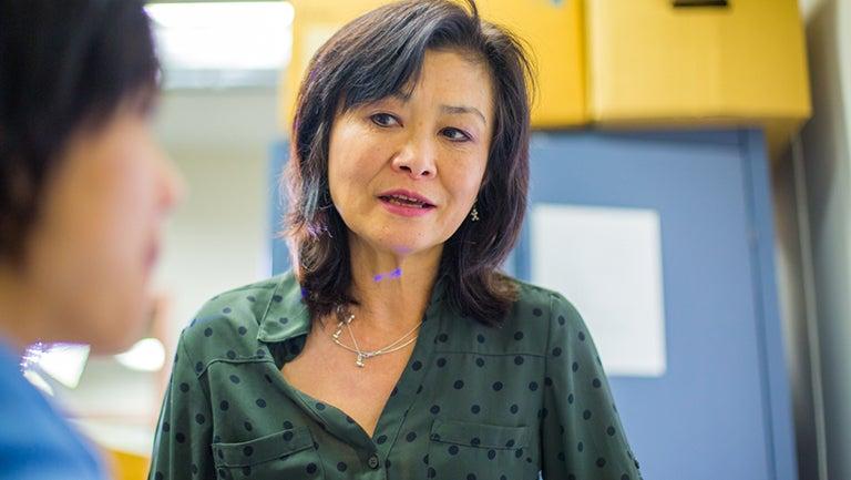 Chemistry professor Toshiko Ichiye talks to a student