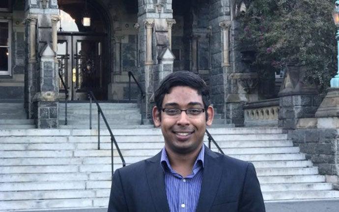 Aditya Pande standing in front of the Healy building