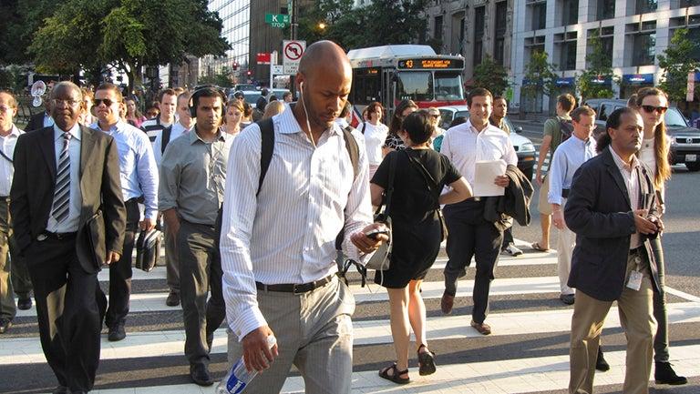 People crossing K Street in Washington, D.C.