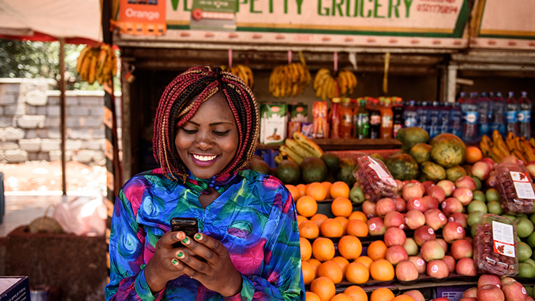 Woman using mobile money network in Kenya
