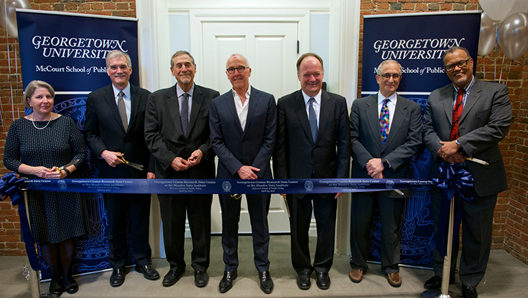 McCourt School, Georgetown leaders with U.S. Census representatives standing with ribbon to cut and open RDC