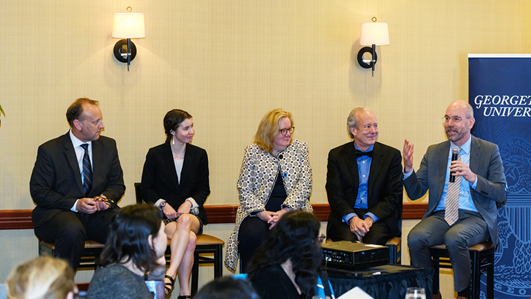 Sitting in chairs Robin Morey, Hannah Funk, Eugenie Dieck, William McDonough and Uwe Brandes, holding microphone