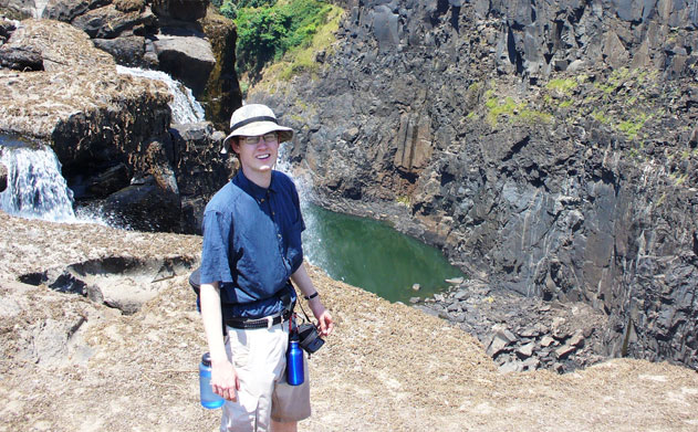 Eric Mooring stands near the edge of a piece of ground while visiting the Zambia side of Victoria Falls