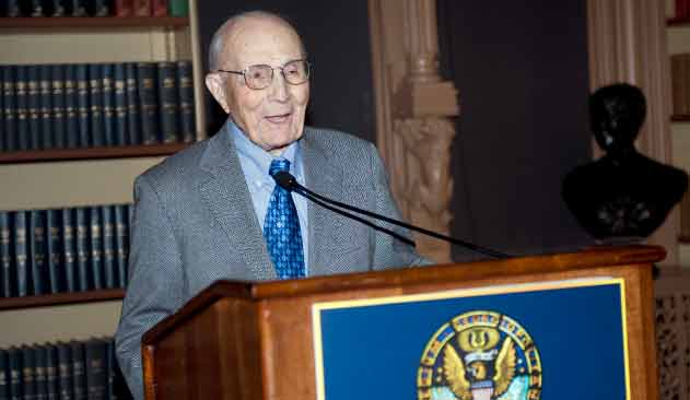 Edmund Pellegrino speaks to an audience from a podium.