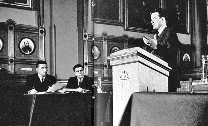 Antonin Scalia, sitting at right, looks on during a Philodemic Debate Society meeting.