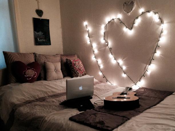 String lights beside a dorm-room bed.