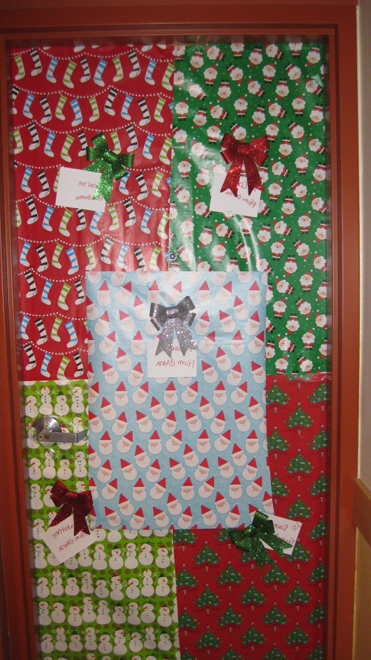 Wrapping paper on the door of a dorm room.
