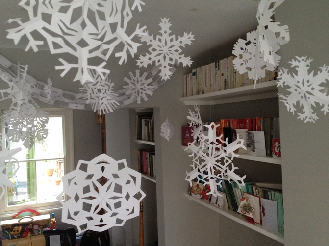 Paper snowflakes hanging from the ceiling.