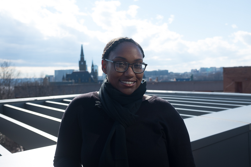 Professor Marcia Chatelain smiles for the camera on a rooftop.