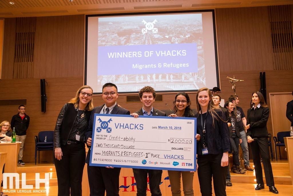Lucy Obus, Yanchen Wang, Jake Glass, Rushika Shekhar and Roisin McLoughlin holding oversize check they won at VHacks