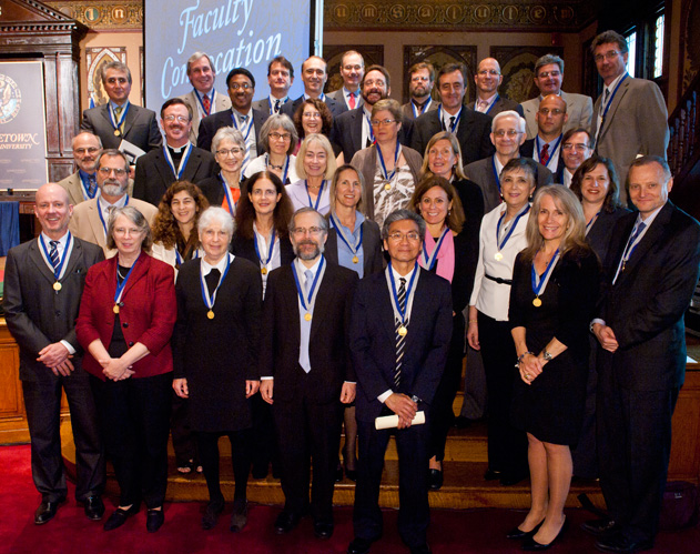 2012 Vicennial Medal Recipients standing on the steps of the Gaston Hall stage