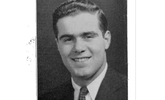 A black and white yearbook photo depicts a young, smiling Atonin Scalia.